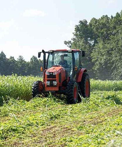 Farm tractor plowing a field