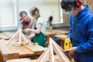 Click on this image of youth working in a shop class to learn about Hamilton County 4-H programs related to vocational goals.