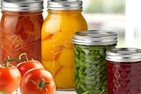 Canning jars with various fruits/vegetables.