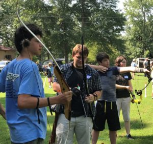 Click on this image of youth with bows at archery practice to learn about 4-H programs related to the outdoors and camp